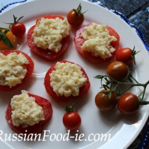 Tomato slices with cheese & garlic. Russian cuisine